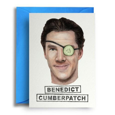 Card on top of sky blue envelope. Card shows an illustration of the head of Benedict Cumberbatch, wearing an eye patch with a cucumber slice instead of a patch.