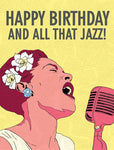 "Front of card shows Billie Holiday with gardenias in hair singing into microphone. Main colors are shades of red, white, and yellow (background). Text at top of card reads ""Happy Birthday And All That Jazz!"""