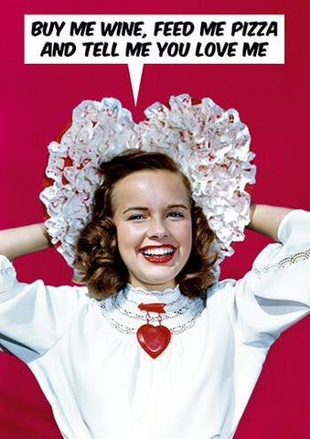 "Front of card with retro image of smiling woman in white blouse and white lace hat, with a large red heart pin, against red background. Text in cartoon balloon reads ""Buy Me Wine, Feed Me Pizza And Tell Me You Love Me."""