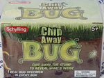 "Chip Away Bug box. Illustration of cross section of lawn with bugs crawling underneath. Text: ""Chip Away The Stump To Reveal What's Inside,"" ""1 Real Bug Specimen In Every Box,"" ""5+,"" Choking Hazard warning."