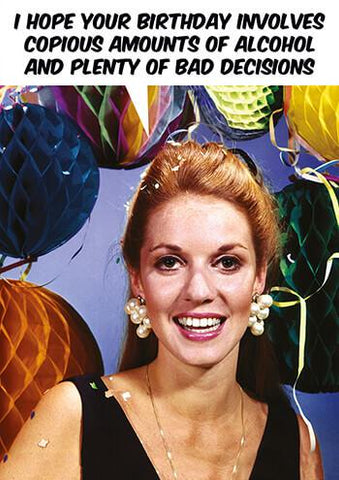"Front of card with image of woman in black dress in front of crepe ball decorations. Text in cartoon balloon reads ""I hope your birthday involves copious amounts of alcohol and plenty of bad decisions."""