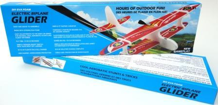 Package of Electric Biplane Glider shows completed glider with white body and red, white, blue, and yellow wings.