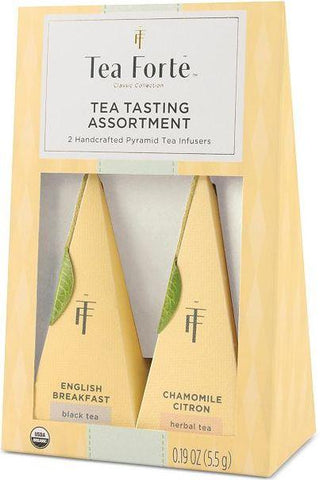 Package of Tea Forté Tea Tasting Assorting, English Breakfast and Chamomile Citron. Cream colored package holds two cream colored pyramid shaped infusers with green leaf at ends of thread.