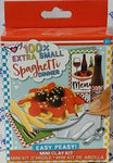 "Package of ""100% Extra Small Spaghetti Dinner"" shows completed craft with spaghetti and meatballs and two breadsticks on plate and placemat, napkin, utensils, menu, and bottle of soda."