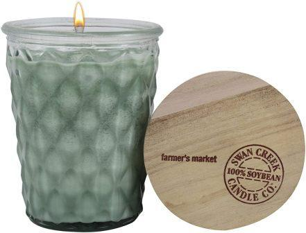 "Swan Creek Farmer's Market Timeless Candle, 12 oz. Green candle in clear glass jar with argyle pattern. Top of lid displayed, showing the text ""farmer's market"" and the ""Swan Creek 100% Soybean Candle Co."" logo."