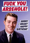 "Front of card with image of young man in business suit smiling smugly. Text at top of card reads ""Fuck You Arsehole!"" in large red letters. Smaller letters next to man read ""Sorry I Meant Happy Birthday."" Blue background."
