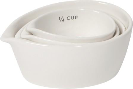 Set of 4 nested white stoneware measuring cups.