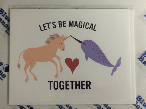 "Front of card with illustration of rainbow maned unicorn and narwhal touching horns, a heart between them. Text: ""Let's Be Magical Together."""