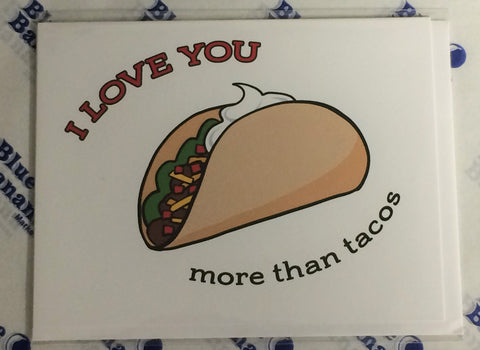"Front of card with illustration of taco against white background and words ""I love you more than tacos."""