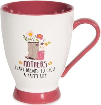 "White mug with tomato red base, handle, and interior. Illustration on mug of large grey rain boots with white polka dots next to small pink rain boots, with flowers sticking out of the boots. Text under illustration reads ""Mothers Plant Dreams To Grow A Happy Life."""