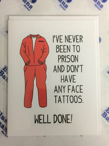 "Front of card shows orange prison uniform in ""standing"" position as if on a body. Text to left of illustration reads ""I've Never Been To Prison And Don't Have Any Face Tattoos."" Text at bottom of card reads ""Well Done!"" White background."