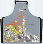 Full skirt of apron reveals a pile of vegetables (orange, yellow, white and black against grey) cut by the knife at top.