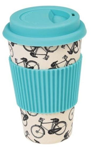 Cream-coloured travel mug with design of bicycles. Light blue silicone lid and sleeve.