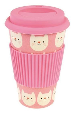 Pink bamboo travel mug with design of white smiling cat faces. Pink silicone lid and sleeve.