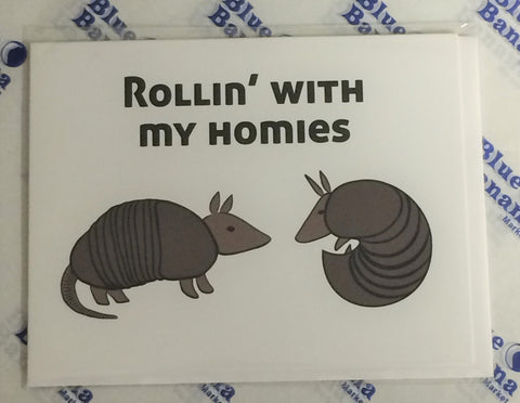 "Front of white card with two cartoon armadillos facing each other, one curled into a ball. Text at top of card reads ""Rollin' With My Homies."""