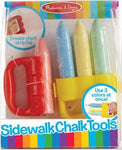 Melissa & Doug Sidewalk Chalk Tools in package. Shows red holder with handle and yellow holder for using three colors at once. Chalk colors are red, blue, yellow, and green.