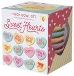 Set of six pinch bowls in colorful package (red, yellow and green with stripes and hearts). Side of package shows the sweet heart candies that the bowls are made to resemble.