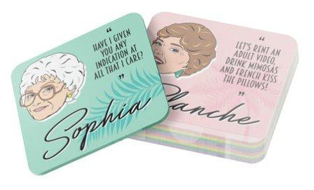Golden Girls Coasters in pile with Sophia and Blanche coasters showing. Pastel colors, illustration of character's head on coaster.