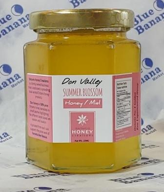 250 g octagon glass jar of Don Valley Summer Blossom honey. Label is pale pink and white. Gold lid has honeycomb pattern.