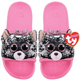 Pale pink kids' slides with face of black, white and pink Beanie Boo character Kiki the Cat across strap. Reversible sequins version of character. Ty logo on heel.
