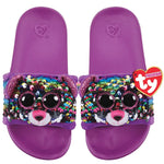 Purple kids' slides with face of multicolored Beanie Boo character Dotty the Leopard across strap. Reversible sequins version of character. Ty logo on heel.
