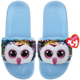 Pale blue kids' slides with face of multicolored Beanie Boo character Owen the Owl across strap. Reversible sequins version of character. Ty logo on heel.