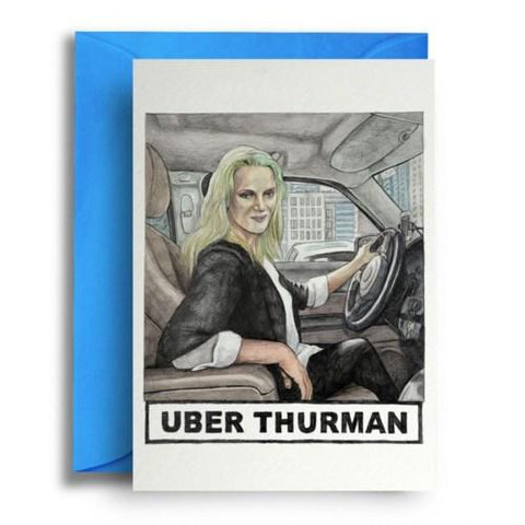 "Card on top of sky blue envelope. Card is white with illustration of Uma Thurman at the wheel of a car. Text underneath reads ""Uber Thurman."""