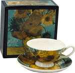 Cup and saucer with detail from Van Gogh's Sunflowers painting, in front of gift box showing full painting.