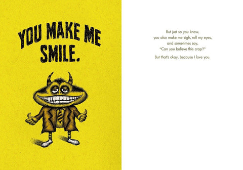 "Front and inside of card. Front of card is yellow with illustration of a smiling horned creature in a suit jacket and tie giving two thumbs up. Text at top of card reads ""You Make Me Smile."""