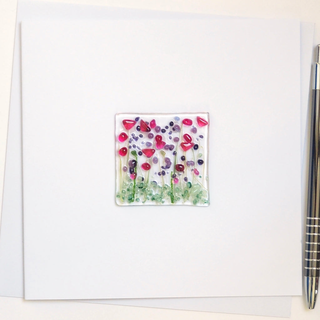 Pink and purple flowers glass greetings card