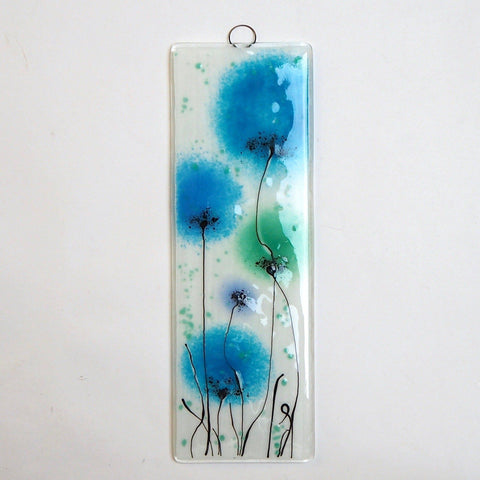 Fused glass wall art with deep turquoise and green flowers - Fired Creations