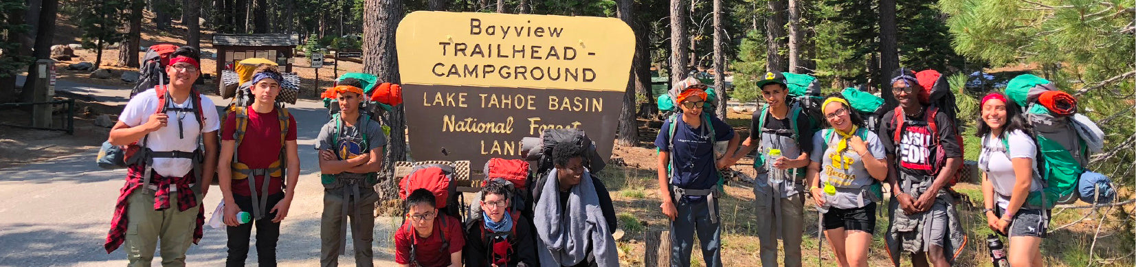 YMCA kids posed for a group picture in front of Bayview Campground trailhead sign