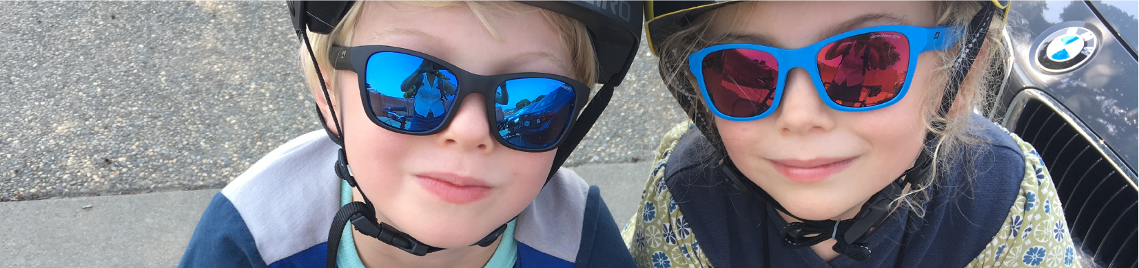 Photo of two of our staffer's children out on a family bike ride.