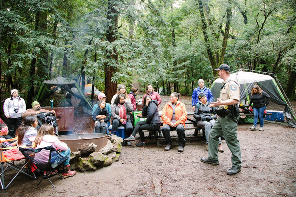 Latino Outdoors members camping while hearing a presentation from a ranger.