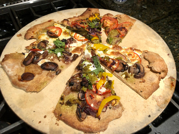 Pizza made from scratch on a wooden board.