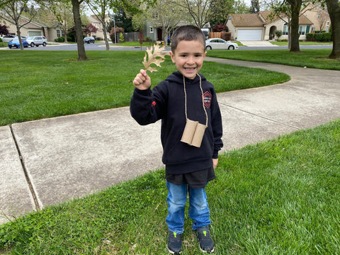 Mike's son holding a pinecone