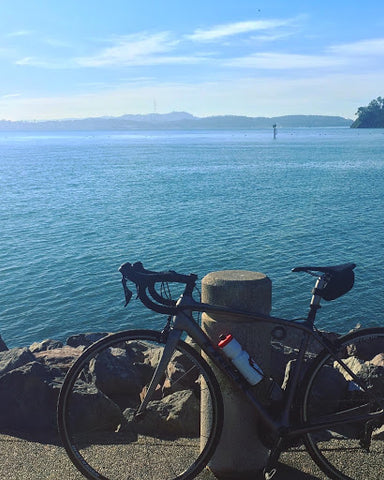Bike leaning on a post in Marin overlooking the water.
