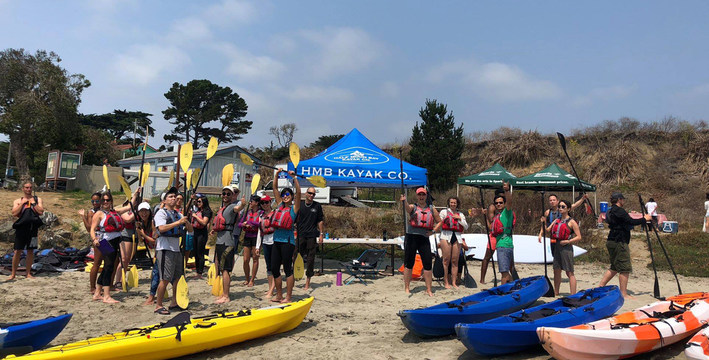Photo of a happy group on a kayaking trip corporate retreat with Sports Basement Outdoors.
