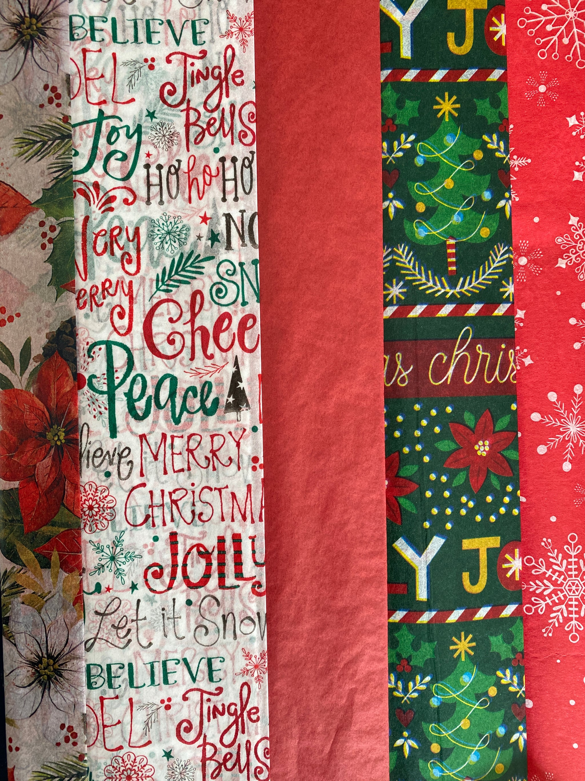 holiday tissue paper with red, green, merry christmas, snowflakes and flowers