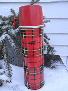 Red plaid thermos with red top