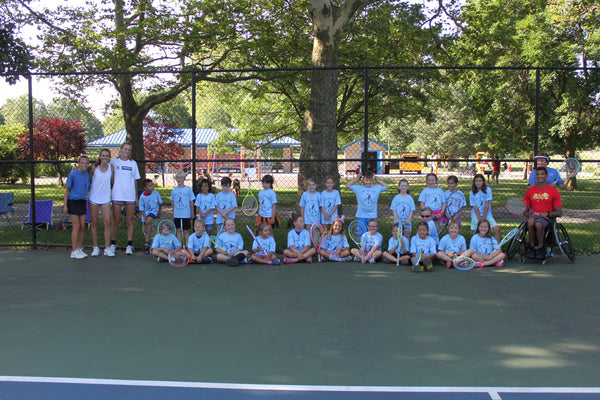 Haley and Brooke volunteering with the Community Tennis kids