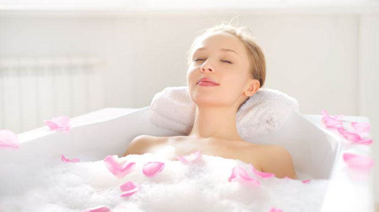 Woman enjoying the benefits of a hot bath