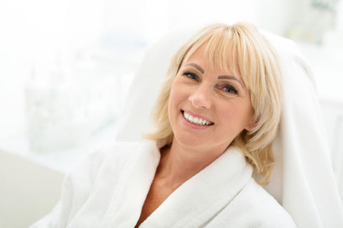Woman relaxing in white robe