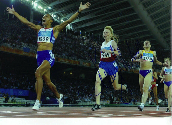 DAME KELLY HOLMES GENUINE HAND SIGNED 12X8 PHOTO ATHENS 2004 OLYMPICS