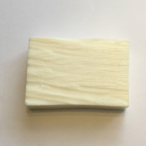 Simple white fragrance-free goat milk soap