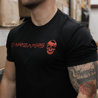 Basic Shirt in black with red logo being worn