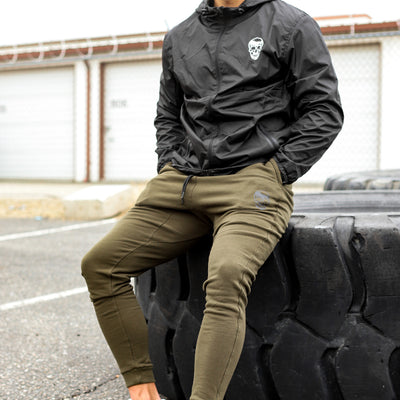 Gymreapers joggers in green color worn outside
