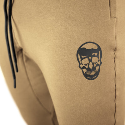 Gymreapers joggers in sand color with white logo