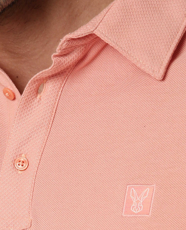 RETURNS-SOLID TEXTURED POLO-ORANGE POLO RARE RABBIT