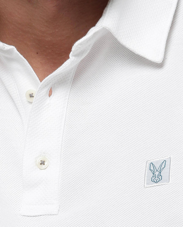 RETURNS-SOLID TEXTURED POLO-WHITE POLO RARE RABBIT